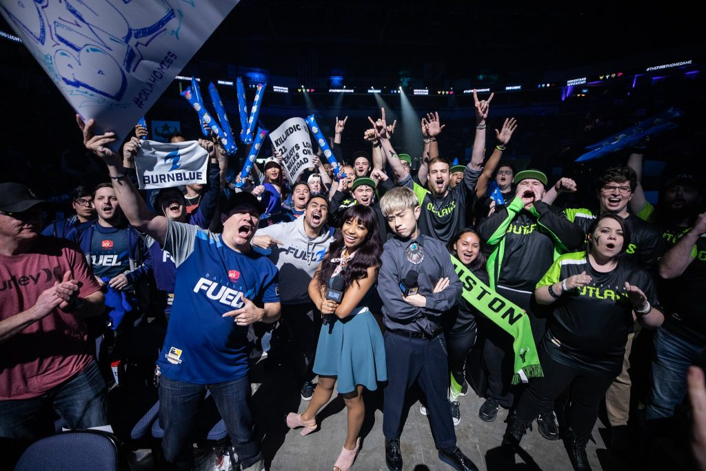 Dallas Fuel and Houston Outlaws fans with broadcasters Danny Lim & Mica Burton